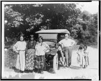 [Gypsy women and children, and man with automobile]